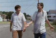 Ryan and Barret talk while walking down a road